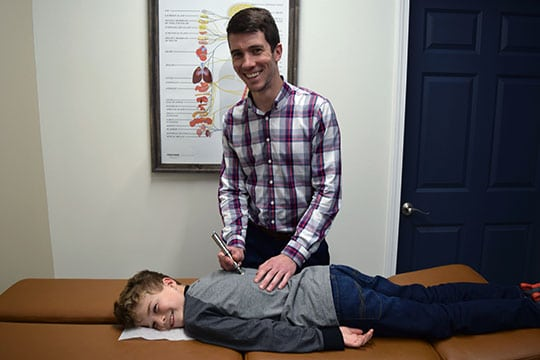 Chiropractor Wauwatosa WI Alexander Young with Boy Patient